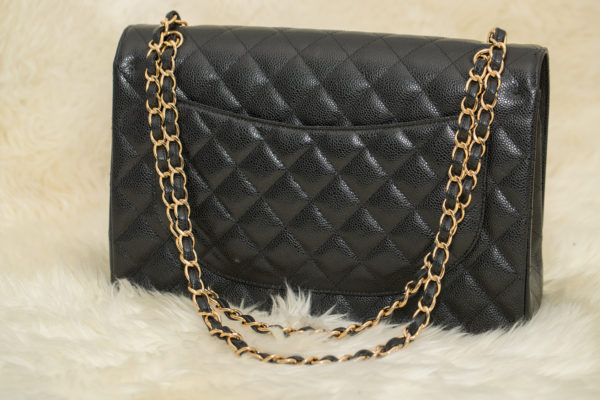 Stylowa czarna pikowana torebka Coco Chanel