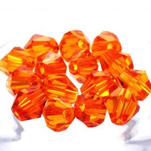 Koraliki bicone ze szkła kryształowego kolor pomarańczowy